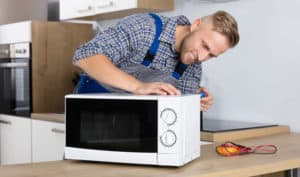 why does my ge microwave keep tripping the breaker